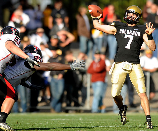 University of Colorado quarterback Cody Hawkins throws a touchdown pass to receiver Paul Richardson during the football game against Texas Tech on Saturday, Oct. 23, at Folsom Field. Texas Tech defeated CU 27-24.<br /> Jeremy Papasso/ Camera