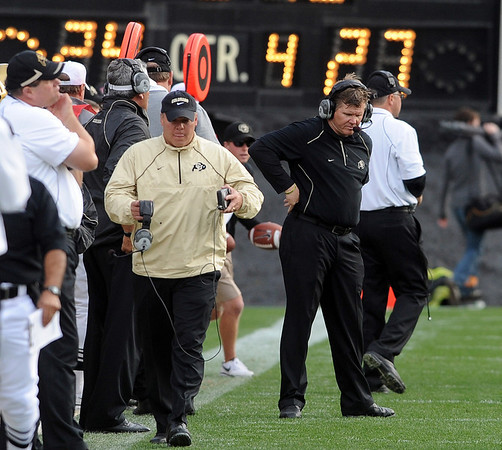 "CU coach Dan Hawkins walks the sidelines during the final seconds of the Texas Tech loss.<br /> For more photos of the game, go to  <a href=""http://www.dailycamera.com"">http://www.dailycamera.com</a>.<br /> Cliff Grassmick / October 23, 2010"