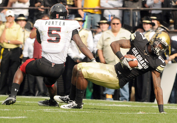 University of Colorado receiver Toney Clemons tries to stay on his feet after making a catch during the football game against Texas Tech on Saturday, Oct. 23, at Folsom Field.<br /> Jeremy Papasso/ Camera