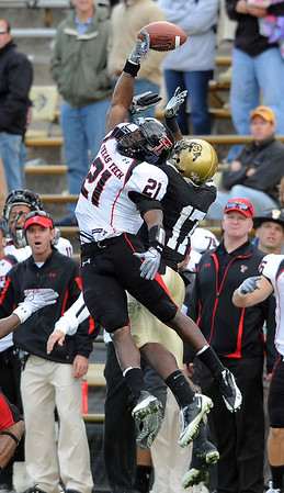 Jarvis Phillips, left, of Texas Tech, knocks the ball away from Toney Clemons, of Colorado,mduring the final seconds of the October 23, 2010, game played in Boulder.<br /> Cliff Grassmick / October 23, 2010
