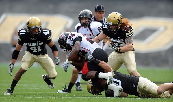 "Terrel Smith (41) and B.J. Beatty close in on   Eric Stephens of Texas Tech.<br /> For more photos of the game, go to  <a href=""http://www.dailycamera.com"">http://www.dailycamera.com</a>.<br /> Cliff Grassmick / October 23, 2010"