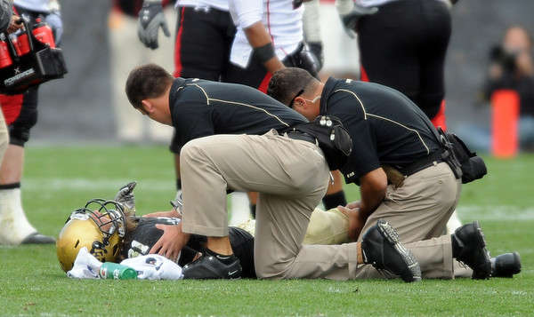 Jon Major injures his knee in the Texas Tech Game.<br /> Cliff Grassmick Photo