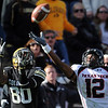 Paul Richardson, left, of Colorado, catches a touchdown pass over D.J. Johnson of Texas Tech during the October 23, 2010, game in Boulder.<br /> Cliff Grassmick / October 23, 2010