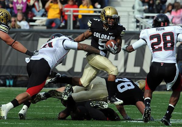 """Rodney Stewart of CU tries to escape Sam Fehoko of Texas Tech.<br /> For more photos of the game, go to  <a href=""""http://www.dailycamera.com"""">http://www.dailycamera.com</a>.<br /> Cliff Grassmick / October 23, 2010"""