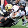 Texas Tech running back Eric Stephens is tackled by University of Colorado freshman Terrel Smith during the football game on Saturday, Oct. 23, at Folsom Field in Boulder, Colo. Texas Tech defeated CU 27-24.<br /> Jeremy Papasso/ Camera