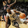 "Dwight Thorne of CU tries to get around Mike Singletary of Texas Tech.<br /> For more basketball photos, go to photo galleries at  <a href=""http://www.dailycamera.com"">http://www.dailycamera.com</a>.<br /> Cliff Grassmick / March 6, 2010"