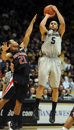 """Marcus Relphorde of CU takes a jumper over John Roberson of     Texas Tech.<br /> For more basketball photos, go to photo galleries at  <a href=""""http://www.dailycamera.com"""">http://www.dailycamera.com</a>.<br /> Cliff Grassmick / March 6, 2010"""