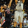 "Marcus Relphorde of CU takes a jumper over John Roberson of     Texas Tech.<br /> For more basketball photos, go to photo galleries at  <a href=""http://www.dailycamera.com"">http://www.dailycamera.com</a>.<br /> Cliff Grassmick / March 6, 2010"