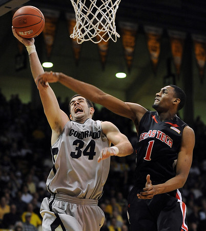 """Casey Crawford  of CU goes up to score past Brad Reese.<br /> For more basketball photos, go to photo galleries at  <a href=""""http://www.dailycamera.com"""">http://www.dailycamera.com</a>.<br /> Cliff Grassmick / March 6, 2010"""