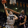 "Casey Crawford  of CU goes up to score past Brad Reese.<br /> For more basketball photos, go to photo galleries at  <a href=""http://www.dailycamera.com"">http://www.dailycamera.com</a>.<br /> Cliff Grassmick / March 6, 2010"
