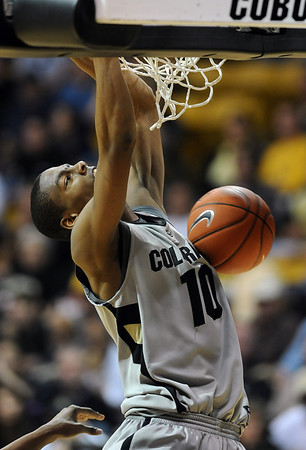 "Alec Burks of CU dunks in the  Texas Tech game.<br /> For more basketball photos, go to photo galleries at  <a href=""http://www.dailycamera.com"">http://www.dailycamera.com</a>.<br /> Cliff Grassmick / March 6, 2010"