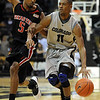 "Cory Higgins of CU drives past D'Walyn Roberts of Texas Tech on Saturday.<br /> For more basketball photos, go to photo galleries at  <a href=""http://www.dailycamera.com"">http://www.dailycamera.com</a>.<br /> Cliff Grassmick / March 6, 2010"