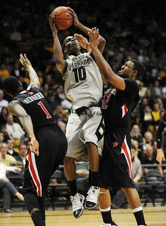 """Alec Burks of CU goes up between Brad Reese, left, and Mike Singletary, both of Texas Tech.<br /> For more basketball photos, go to photo galleries at  <a href=""""http://www.dailycamera.com"""">http://www.dailycamera.com</a>.<br /> Cliff Grassmick / March 6, 2010"""