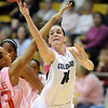 """Meagan Malcolm-Peck scores around Shauntal Nobles of Texas Tech.<br /> For more photos of the CU game, go to  <a href=""""http://www.dailycamera.com"""">http://www.dailycamera.com</a>.<br /> Cliff Grassmick / February 12, 2011"""