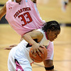 "Ashley Wilson of CU gets past Shauntal Nobles of Texas Tech.<br /> For more photos of the CU game, go to  <a href=""http://www.dailycamera.com"">http://www.dailycamera.com</a>.<br /> Cliff Grassmick / February 12, 2011"