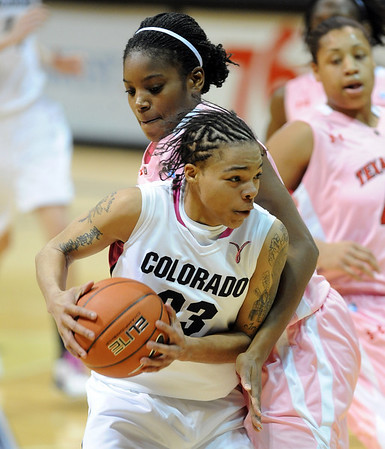 "Chucky Jeffery of CU tries to drive on Kierra Mallard of Texas Tech on Saturday.<br /> For more photos of the CU game, go to  <a href=""http://www.dailycamera.com"">http://www.dailycamera.com</a>.<br /> Cliff Grassmick / February 12, 2011"