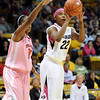 """Brittany Spears of CU shoots over Kierra  Mallard of Texas Tech.<br /> For more photos of the CU game, go to  <a href=""""http://www.dailycamera.com"""">http://www.dailycamera.com</a>.<br /> Cliff Grassmick / February 12, 2011"""