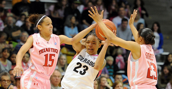 "Chucky Jeffery of CU is double teamed by Casey Morris (15) and Monique Smalls of Texas Tech.<br /> For more photos of the CU game, go to  <a href=""http://www.dailycamera.com"">http://www.dailycamera.com</a>.<br /> Cliff Grassmick / February 12, 2011"