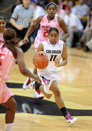 "Brittany Wilson of CU breaks the Texas Tech press on Saturday.<br /> For more photos of the CU game, go to  <a href=""http://www.dailycamera.com"">http://www.dailycamera.com</a>.<br /> Cliff Grassmick / February 12, 2011"