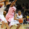 "Brittany Wilson of CU tries to get around Christine Hyde of Texas Tech.<br /> For more photos of the CU game, go to  <a href=""http://www.dailycamera.com"">http://www.dailycamera.com</a>.<br /> Cliff Grassmick / February 12, 2011"