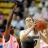 "Rachel Hargis of CU shoots over Teena Wickett of Texas Tech.<br /> For more photos of the CU game, go to  <a href=""http://www.dailycamera.com"">http://www.dailycamera.com</a>.<br /> Cliff Grassmick / February 12, 2011"