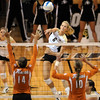 Kerra Schroeder of Colorado hits over the defense of Texas.<br /> Cliff Grassmick / September 23, 2009