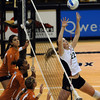 Kaitlyn Burkett of Colorado sets against Texas on Wednesday.<br /> Cliff Grassmick / September 23, 2009