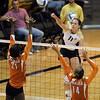 Rosie Steinhaus of Colorado hits over Destinee Hooker, left, and Sha'Dare McNeal of Texas.<br /> Cliff Grassmick / September 23, 2009