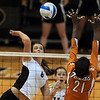 Nikki Kinzer of CU tries to hit past Destinee Hooker of Texas.<br /> Cliff Grassmick / September 23, 2009
