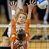 Becah Fogle of CU tries to hit past Ashley Engle of Texas.<br /> Cliff Grassmick / September 23, 2009