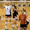 Kerra Schroeder, left, and Ellen Henry of Colorado celebrate a point against Texas.<br /> Cliff Grassmick / September 23, 2009