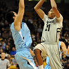 "Andre Roberson of CU scores over Cosmo Morabbi of The Citadel.<br /> For more photos of the game, go to  <a href=""http://www.dailycamera.com"">http://www.dailycamera.com</a>.<br /> Cliff Grassmick / December 17, 2010"
