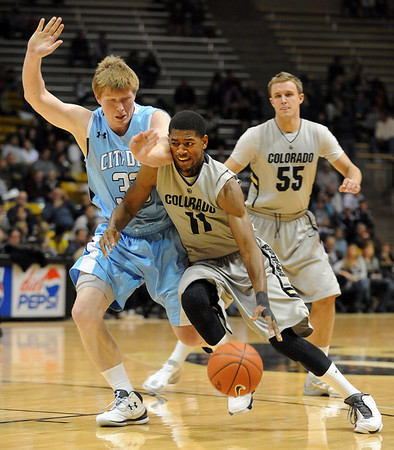 """Cory Higgins of CU dribbles into Daniel Eykyn of The Citadel.<br /> For more photos of the game, go to  <a href=""""http://www.dailycamera.com"""">http://www.dailycamera.com</a>.<br /> Cliff Grassmick / December 17, 2010"""