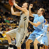 "Ben Mills of Colorado scores past Matt Clark of The Citadel.<br /> For more photos of the game, go to  <a href=""http://www.dailycamera.com"">http://www.dailycamera.com</a>.<br /> Cliff Grassmick / December 17, 2010"