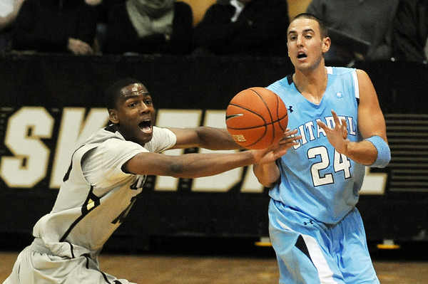 """Alec Burks of CU knocks the ball away from Austin Dahn of the Citadel.<br /> For more photos of the game, go to  <a href=""""http://www.dailycamera.com"""">http://www.dailycamera.com</a>.<br /> Cliff Grassmick / December 17, 2010"""