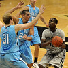 Alec Burks, right, of Colorado, looks to shoot over Mike Groselle (31) and Austin Dahn of the Citadel during the first half of the December 17, 2010 game in Boulder.<br /> Cliff Grassmick / December 17, 2010