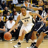 Chucky Jeffery of Colorado drives on Keyonna Johnson of UC-Irvine.<br /> <br /> Cliff Grassmick /November 15, 2009