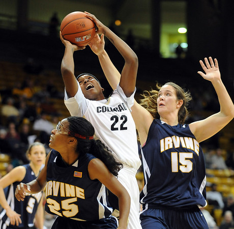 Brittany Spears of CU goes up on Keyonna Johnson, left, and Kim Barnes of UC-Irvine on Sunday.<br /> <br /> Cliff Grassmick /November 15, 2009