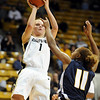 Alyssa Fressle of CU shoots over Jazmyne White of UC-Irvine on Sunday.<br /> <br /> Cliff Grassmick /November 15, 2009