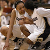 Chucky Jeffery, left, and Whitney Houston talk at the scorers table on Sunday.<br /> <br /> Cliff Grassmick /November 15, 2009