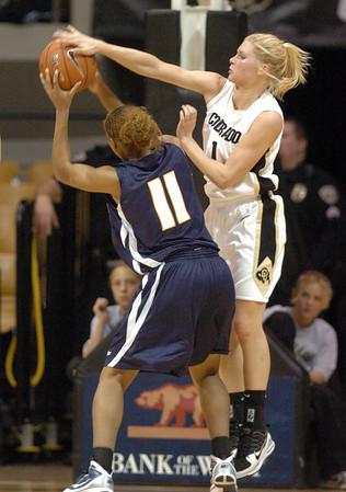 Alyssa Fressle of Colorado, blocks the shot of Jazmyne White of UC-Irvine on Sunday.<br /> <br /> Cliff Grassmick /November 15, 2009