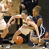 Meagan Malcolm-Peck of CU  scrambles for a loose ball with Jazmyne White of UC-Irvine.<br /> <br /> Cliff Grassmick /November 15, 2009