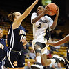 Whitney Houston of CU drives in against Lauren Spinazze of UC-Irvine on Sunday.<br /> <br /> Cliff Grassmick /November 15, 2009