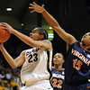 Chucky Jeffery of CU gets around Ariana Moorer of Virginia.<br /> <br /> Cliff Grassmick / January 2, 2010