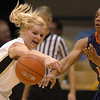 Alyssa Fressle of CU  knocks the ball from Ariana Moorer of Virginia on Saturday.<br /> <br /> Cliff Grassmick / January 2, 2010