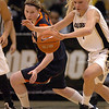 Alyssa Fressle  of CU gets a steal from Lexie Gerson of Virginia.<br /> <br /> Cliff Grassmick / January 2, 2010