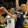 Chucky Jeffery of CU drives on Jayna Hartig of Virginia.<br /> <br /> Cliff Grassmick / January 2, 2010