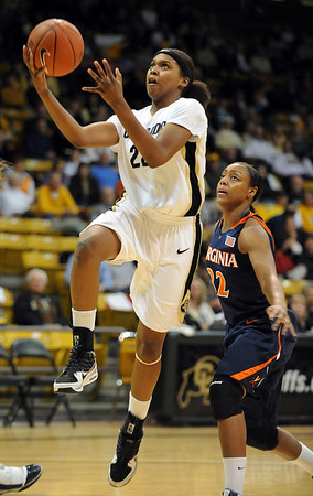 Brittany Spears of CU drives past the Virginia defense on Saturday.<br /> <br /> Cliff Grassmick / January 2, 2010