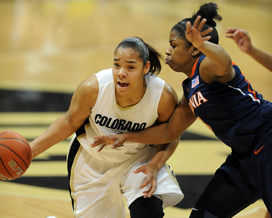 Bianca Smith  of CU gets pressure by Paulisha Kellum of Virginia while trying to get set up for a three point sound late in the game.<br /> <br /> Cliff Grassmick / January 2, 2010