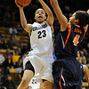 Chucky Jeffery of Colorado drives past Simone Egwu of Virginia.<br /> <br /> Cliff Grassmick / January 2, 2010